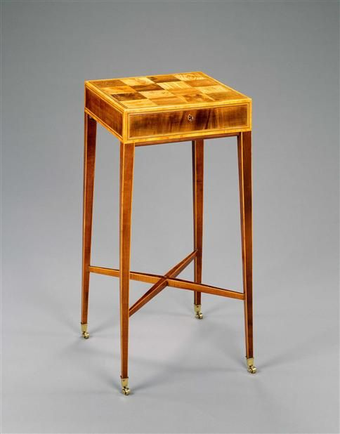 A GEORGE III SPECIMEN WOOD WORK TABLE An elegant late 18th century work table, the specimen parquetry top having sixteen veneers of exotic woods including tulipwood, burr yew and zebra wood within a satinwood border with boxwood and ebony stringing, above a single mahogany drawer and square tapering legs with 'X' stretcher and ending in brass box castors.