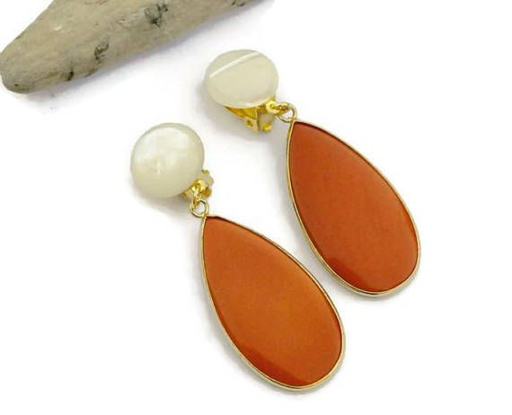 Orange earrings, Clip on earrings. Gorgeous large statement Orange and shell earrings. This model is long, feminine and dainty. This unique design is perfect for all summer days or as wedding jewelry or as gift for her#earrings #jewellery #jewels #jewelrydesign #bijouxcreateur #bijouxfantaisie #bijouxtendances #girl #gorgeous #orange #handmade