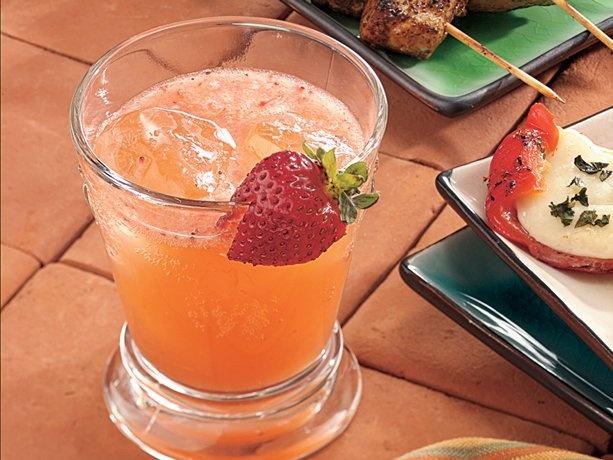 Strawberry Sangria. 2 boxes frozen sliced strawberries (thawed), 1 can frozen orange,
