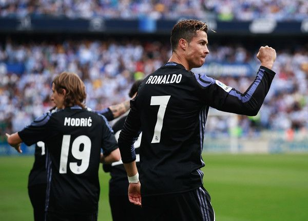 Cristiano Ronaldo of Real Madrid celebrates after his side are crowned champions following the La Liga match between Malaga and Real Madrid at La Rosaleda Stadium on May 21, 2017 in Malaga, Spain.