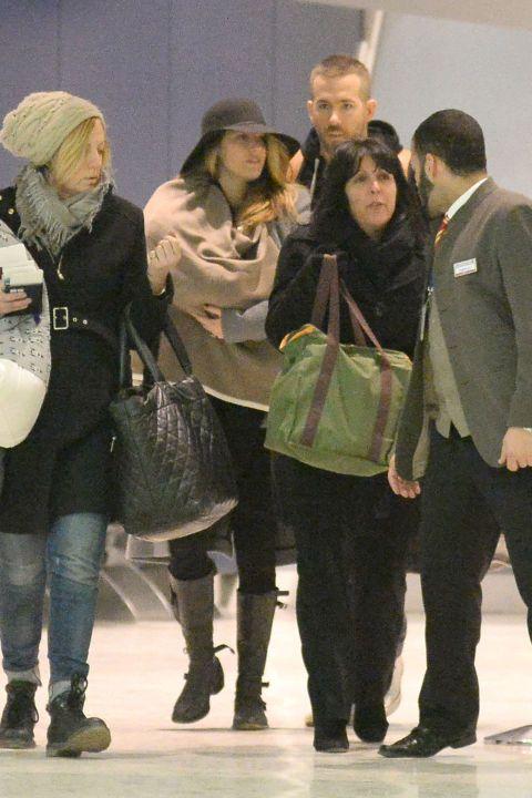 Ryan Reynolds and Blake Lively walk through JFK Airport in New York City with their newborn baby girl.