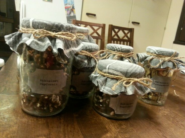 Chocolate pop corns and white chocolate cashews. Christmas presents for friends and family. Lid covers made out of my husband's old shirt! :)