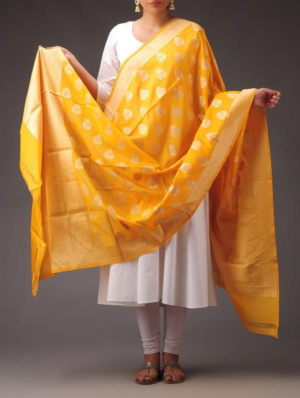 This dupatta is hand crafted on pit looms with traditional techniques. This exquisite Banarasi pure silk georgette dupatta has traditional mogul motif scattered all over. Edged with brocade zari border it has wide pallus on both ends. Combined with appropriate jewelry or accessories it looks stunning for any occasion.