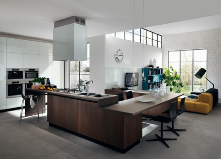 The LiberaMente #kitchen expresses its potential also in unconventional spaces. The variety of  solutions and the wide range of finishes (including Oak veneered finished and a variety of colours for glass surfaces) allow  for compositional creativity and freedom in all cases. #Scavolini