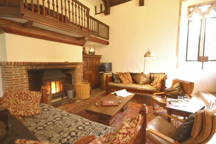 The vast living room, with high ceilings reaching up into the original roof beams of the church. There are two daybeds and two armchairs for comfortable seating as well as a grand piano if you feel like entertaining. If you just want to relax there is a flat screen television and a wide selection of DVDs.  http://www.bestofsuffolk.co.uk/suffolk-cottages/rishangles-old-church.asp