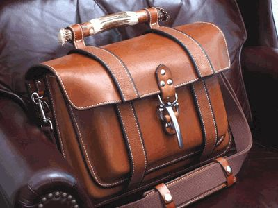 Skytop's Colorado Pullman Briefcase, Old School meets New School.  It fits laptop, tablet, charging cords, work-papers and lots more.  Argentinian Leather, American Bison Straps, Handle made from HIckory, Elk Antler, Deer Antler End Caps.