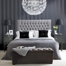 Gray on gray striped wallpaper in bedroom. Love everything about it.