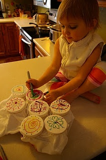 Sharpie markers with scant drops of alcohol added after it's dry. To create tie dye effect.