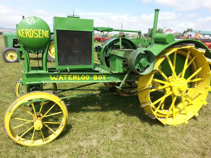"""Early 1920's Waterloo Boy model N tractor. Waterloo Boy was bought by John Deere in 1918. For five years following the merger, the tractors continued to be known by the name """"Waterloo Boy."""" Then in 1923, a powerful new machine was placed on the market under the identity of John Deere Model """"D."""" Few, if any, tractors of whatever make or model have been so popular."""
