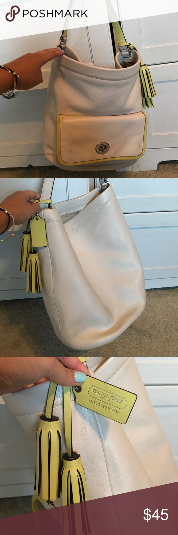 Coach hobo bag This is a white coach hobo bag. It has been used and has normal wear and markings. Many black markings on bag and on bottoms. This bag also has lime green detailing. There is a pocket on the front of the bag big enough to fit a wallet. Coach Bags Hobos
