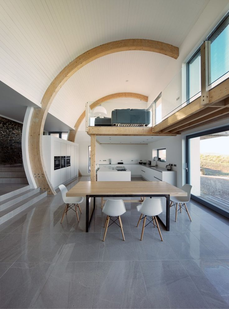 100 year old Irish house restored with curving roof extension by 2020 Architects