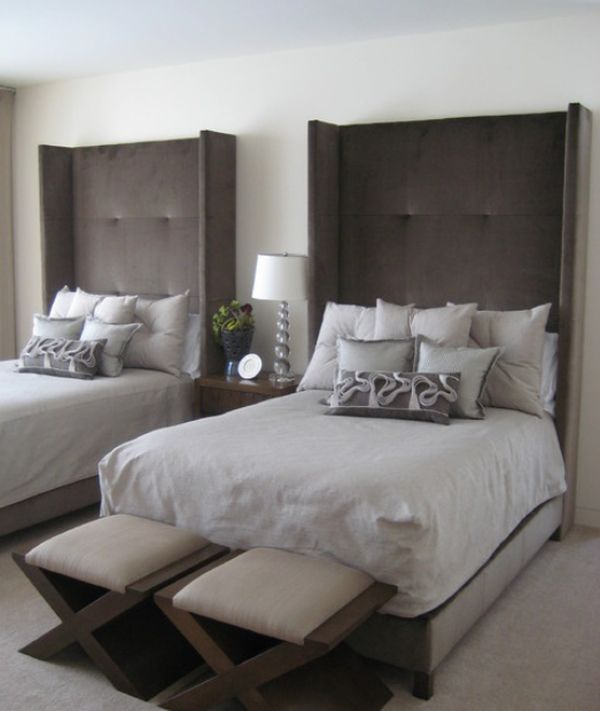 Stylish bedroom featuring tall wingback headboards with a strong presence