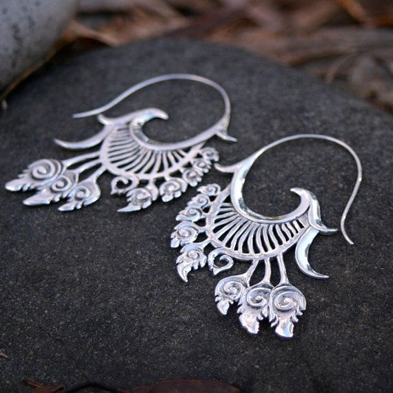 These beautiful feathering, fanning, cascading earrings are solid sterling silver. Inspired by feathers, wings, native american headdresses,