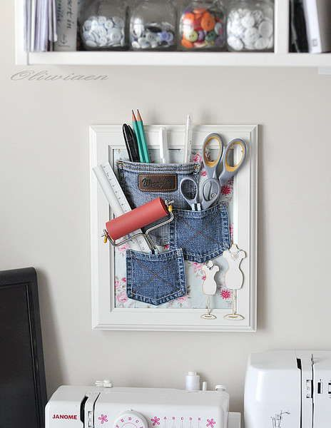 These old denim jean pockets were sewn onto a piece of fabric and put into an Ikea frame and used for supplies.