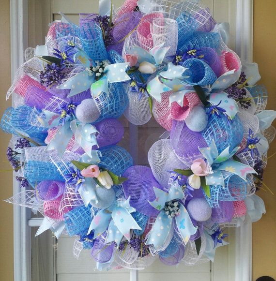 This soft pastel colored wreath helps you welcome not only your family and friends..but the sweet warm breath of Spring! And since Easter