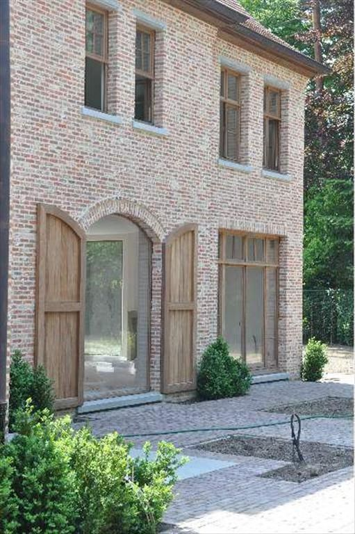 Belgian design. Bright wooden shutter doors with bright brick. Love the brick work #WoodWorking