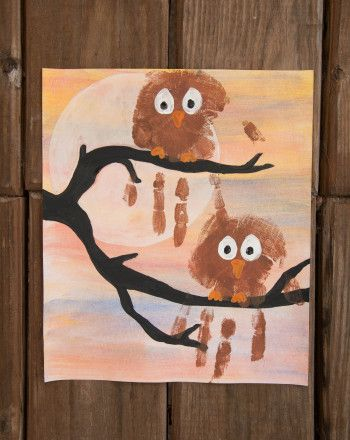 Make an owl painting with your child this Halloween. This owl painting features an autumn landscape created by layering images and a pair of handprint owls.