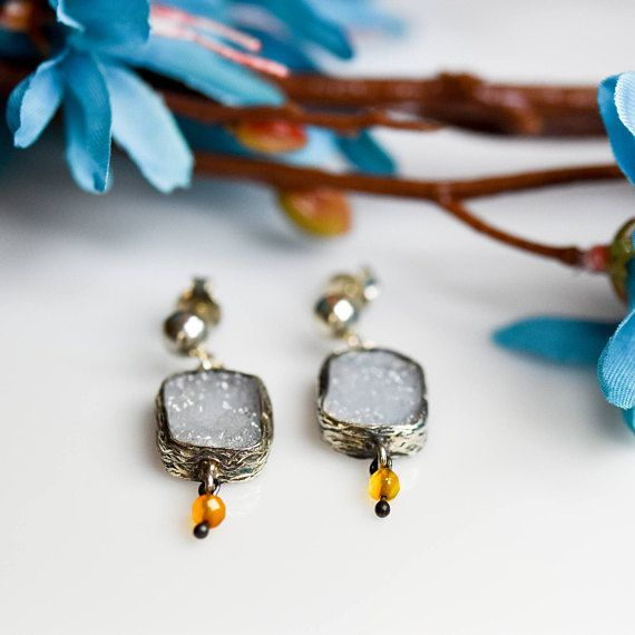 Beautiful Silver Raw Blue Chalcedony Earrings,with Akik Stones .The shape and color of the gem may slightly vary.A creative stone, Blue Chalcedony imparts mental flexibility and verbal dexterity. It stimulates the ability to learn new languages and improves memory. Gives feelings of