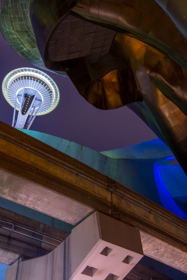Frank Gehry designed EMP Experience Music Project building with the Space Needle in the background in Seattle #blurrdMEDIA #architecture #photography