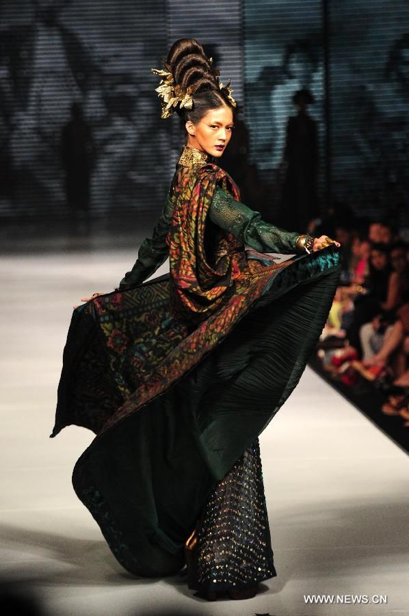 A model presents a creation by Indonesian designer Deden Siswanto
