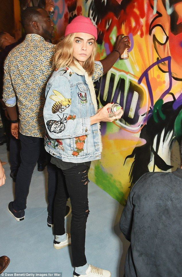 Street syle: Cara, who plays Enchantress in the DC Comics adaptation, rocked a hot pink beanie, a decorative denim jacket and skinny black jeans