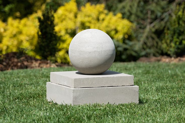 stone sphere on contemporary plinth for landscape / garden design