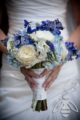 These bouquets feature shades of blue hydrangea, delphinium, veronica, garden roses, and dusty miller.