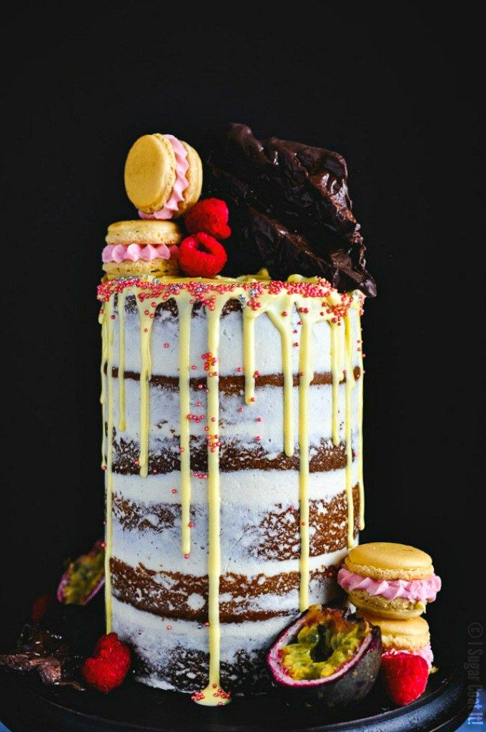 Passion Fruit Raspberry Naked Birthday Cake. Six layers of vanilla bean passion fruit cake filled with raspberry compote and brown butter buttercream.