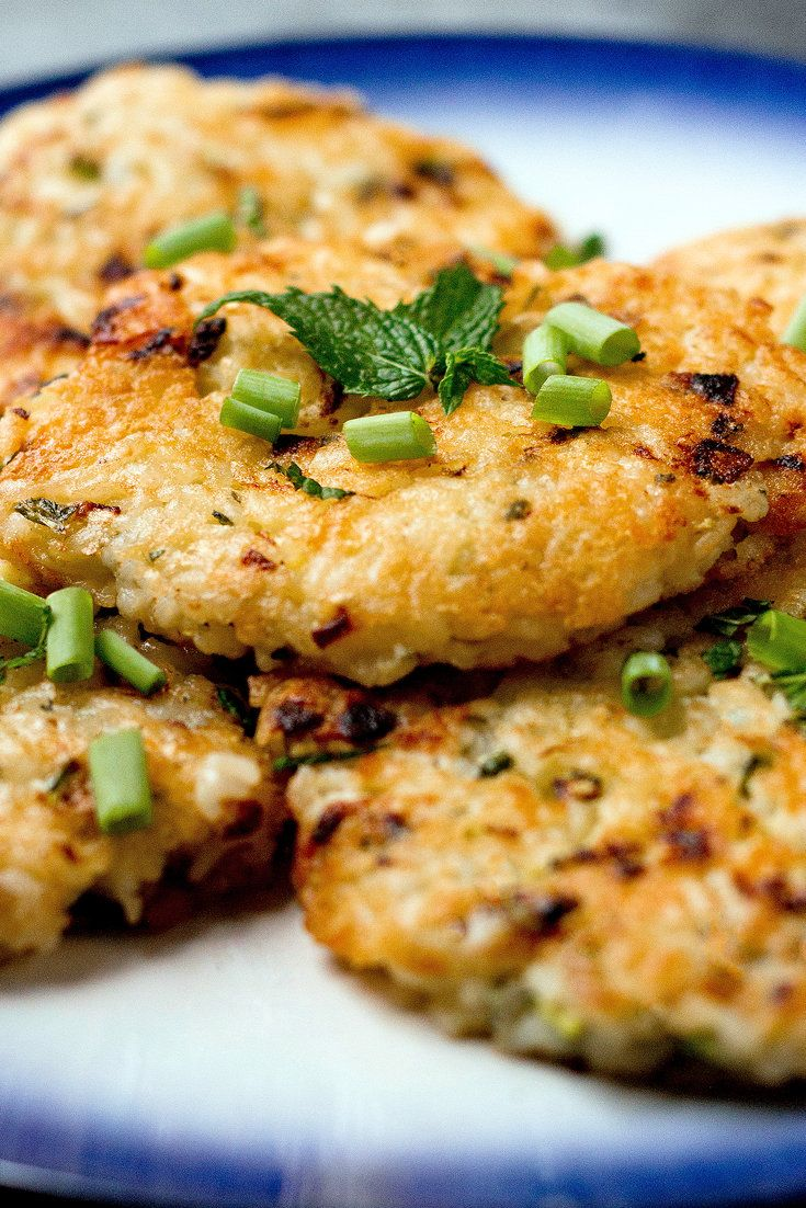 NYT Cooking: Crispy rice has a revered place in many cultures. These rice cakes, which work well as a side dish to a piece of grilled meat or fish, offer the delicious crunch of Korean nurunji or Middle eastern hkaka, with some of the herbed cheesy goodness of Italian arancini. The basic recipe can be used to accommodate vegetables other than zucchini and herbs other than mint,%2...