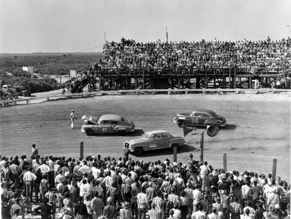 9. Drivers narrowly avoiding a stalled race car: Daytona Beach, February 1952