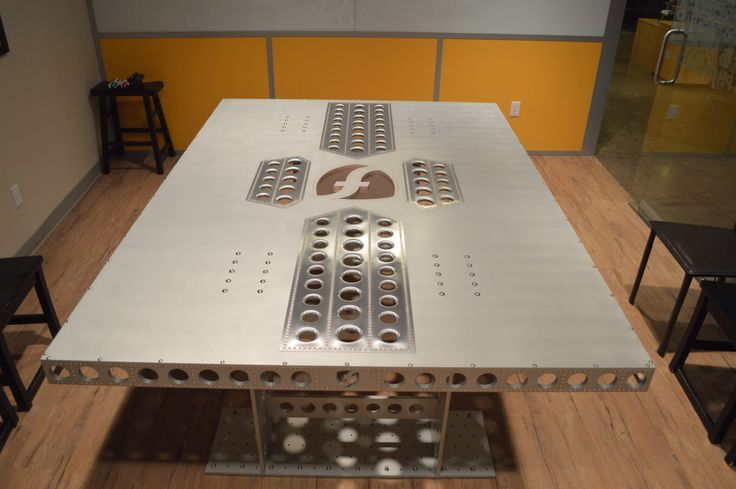 Button head bolts in aluminum table.