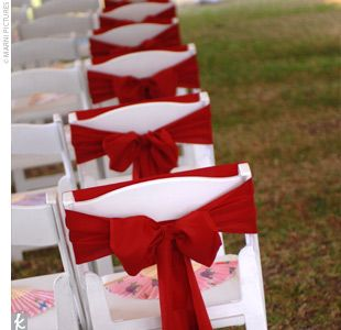 Bright red sashes to add a touch of color to the chairs lining the aisle.