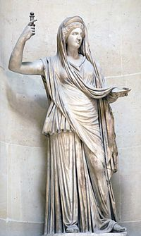 Hera, a Greek goddess, is Zeus' wife and one of his three sister. She was raised by the Titans Ocean and Tethys. She is the supreme goddess, and goddess of marriage & childbirth.