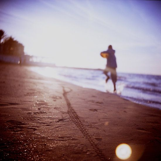 Boy running on beach square Lubitel lomo lomographic lomography medium format  color film analogue photo
