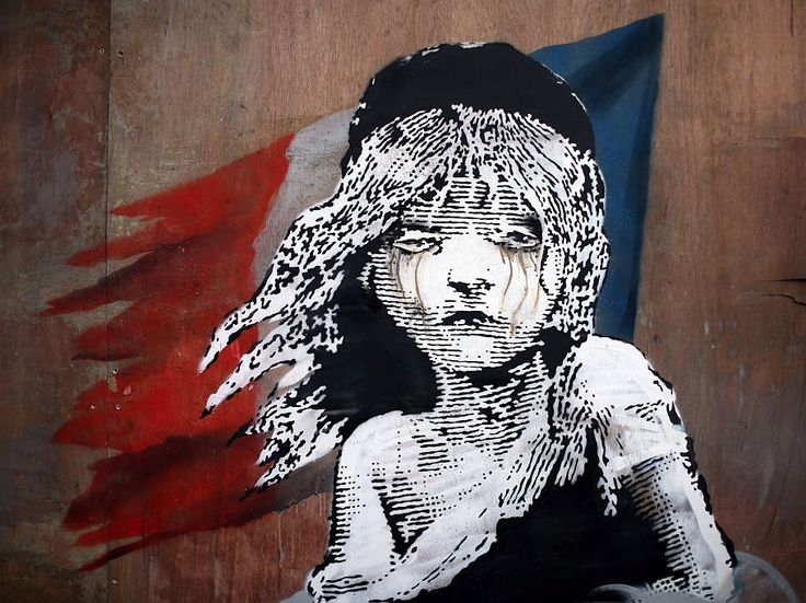 les mis cosette banksy art. This Banksy artwork was created opposite the French embassy on January 25, 2016 in London, England. The graffiti, which depicts a young girl from the musical Les Miserables with tears in her eyes as CS gas moves towards her, criticises the use of teargas in the 'Jungle' migrant camp in Calais.