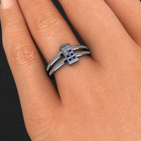 Dr. Who Tardis ring, by DTEK designs on Etsy. $1,100 U.S. dollarss. In yellow gold, rose gold, white gold, or platinum. No word if those are conflict free diamonds. I usually hate diamond rings, but it turns out there is an exception...