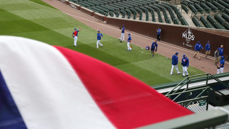 October 11, 2017:  NLDS Game 4: Cubs-Nationals  -  A banner flaps in the wind as Cubs pitchers warm up before the game was postponed Tuesday.