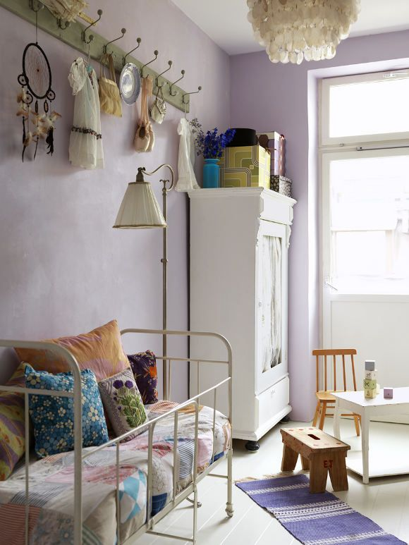 Love this little-girl room: lavender, awesome pillows, armoire, child-sized table, purple rug.