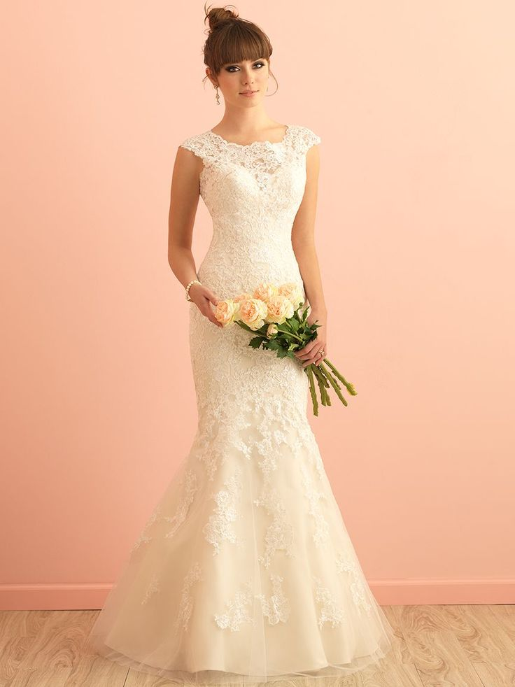 Allure Roman 2864 A softly scooped neckline and gorgeous back detailing are featured in this lace gown.