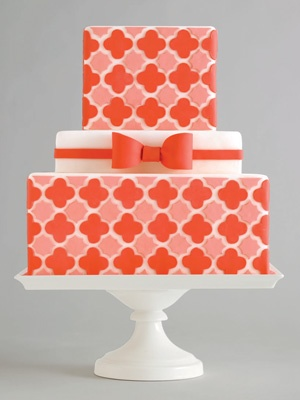 Coral geometric wedding cake - could mix in some of the aqua or turquoise with this :)