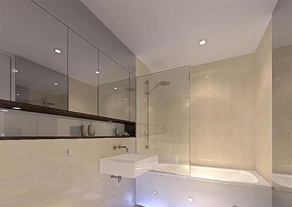Mirrored cabinets recessed from wall