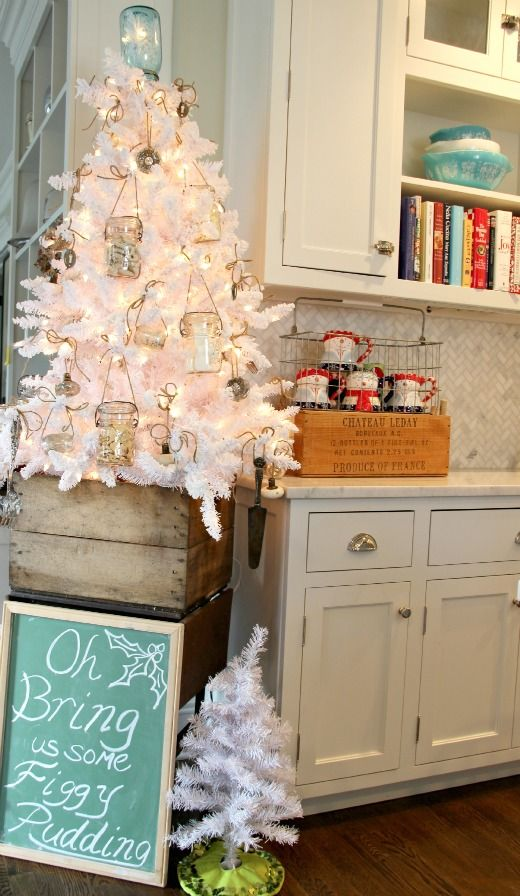 Vintage White Christmas Tree - Christmas decorating with white lights, ball mason jars filled with big puffy marshmallows, popcorn, and white icing treats...also, old doorknobs, key holes, mercury glass napkin rings, and vintage silver.  Flocking is sugar cookie icing.