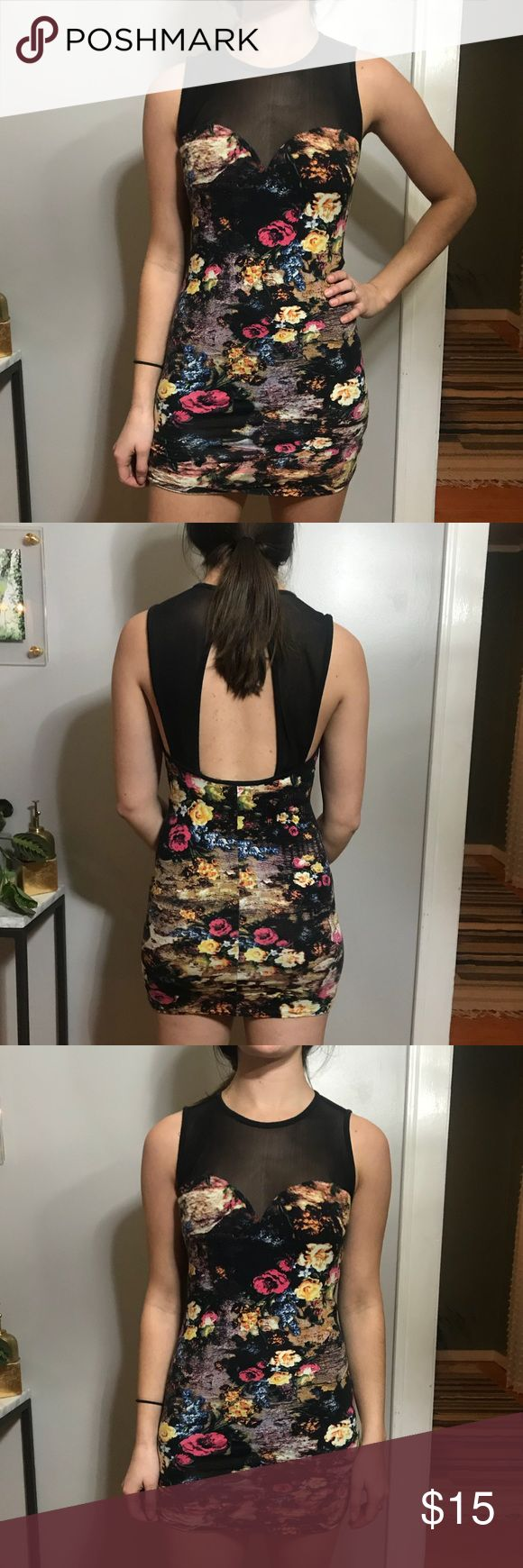 Urban Outfitters Minidress Such cute detail, great for a night out! Model is 5'9 and a size 6. Great used condition. Multicolored floral pattern with cut-out back detail in transparent fabric Urban Outfitters Dresses Mini