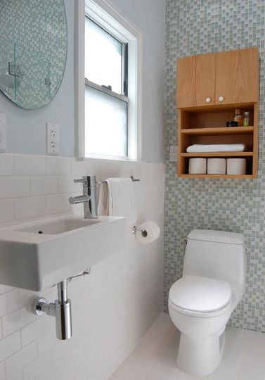 A tiny sink made all the difference in transforming a formerly cramped and dark bathroom into one that feels bright and spacious.