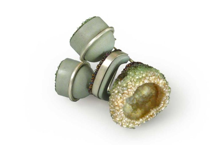 Andrea Wagner Brooch: Cape Canaveral Porcelain, glass, and possibly other media, silver, wood, acrylic color and fibre: