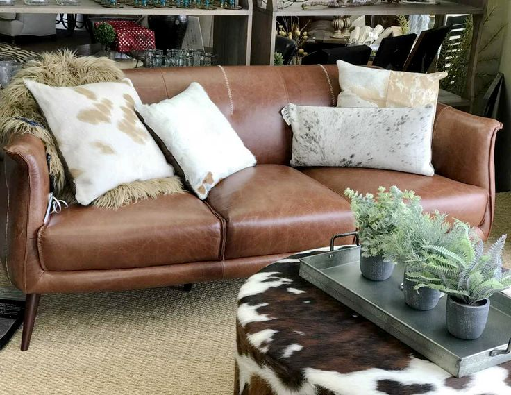 It's all spring vibes in our mountain town.#leathersofa #cowhide #greenplants