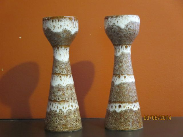 pair of ceramic candlesticks with the signature Chalvignac drippy lava glaze