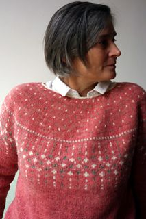 Waiting for spring is a sweater knit top down, with circular yoke and delicate colorwork. Knit in fingering weight, this sweater is light and warm.