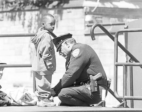 """While taking a routine vandalism report at an elementary school, an officer was interrupted by a little boy about six years old. Looking up and down at his uniform, he asked, """"Are you a cop?""""    """"Yes,"""" he replied and continued writing the report.    """"My mother said if I ever needed help I should ask the police. Is that right?""""    """"Yes, that's right,"""" he told him.    """"Well, then,"""" he said as he extended his foot towards the officer, """"would you please tie my shoe?"""""""