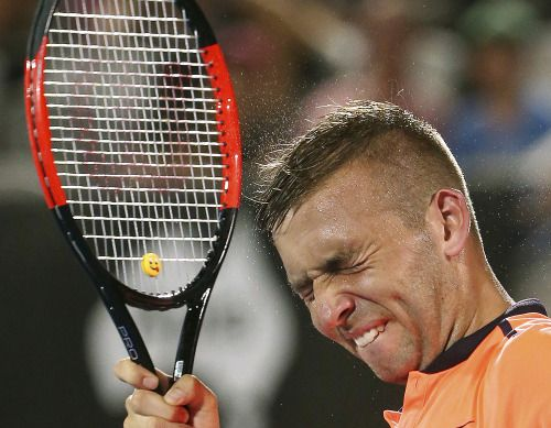 Photos of the day - January 13 2017Britains Daniel Evans...  Britain's Daniel Evans grimaces after losing a service game to Andrey Kuznetsov of Russia in their men's semifinal singles match at the Sydney International tennis tournament. (Photo: Rick Rycroft/AP) Huge waves crash on the San Esteban de Pravia seafront in the northern Spanish region of Asturias Spain Jan. 13 2017. (Photo: Eloy Alonso/Reuters) A member of Iraqi Federal police fire toward Islamic State militants during clashes…